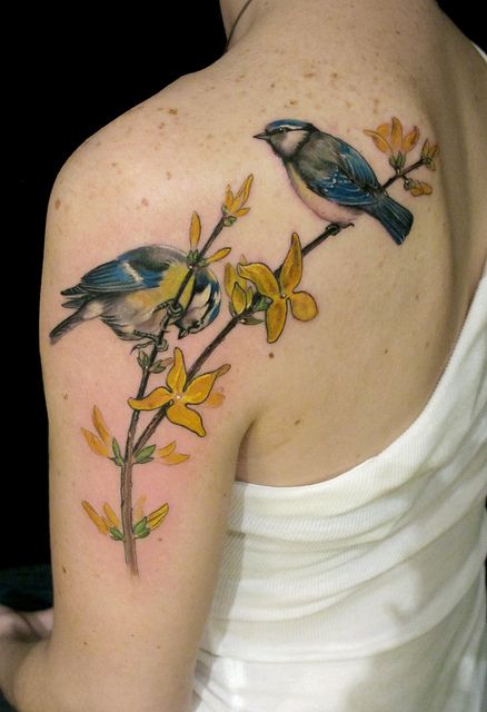 Blue birds and yellow tattoo