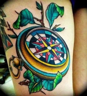 Blue lovely compass tattoo on arm