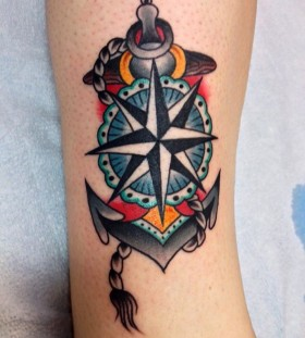 Blue lovely compass tattoo on leg