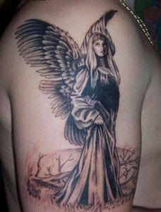 Brown and black angel tatoo on arm