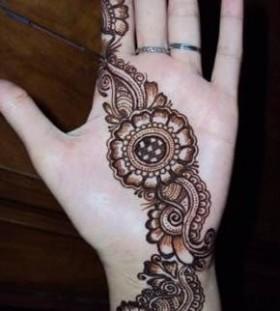 Brown round Henna and Mehndi design tattoo