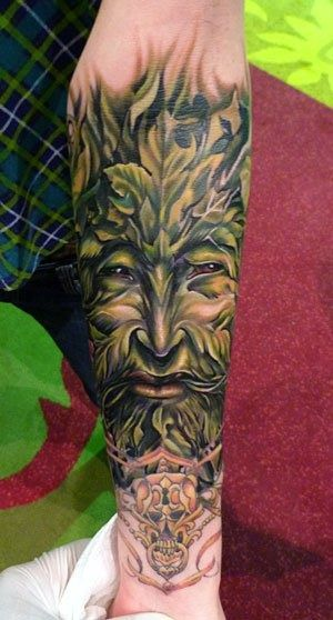 Celtic God green tattoo