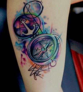 Colorful anchor compass tattoo on leg