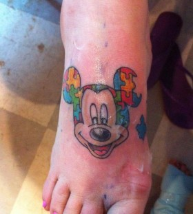 Colorful puzzles Mickey Mouse tattoo on arm