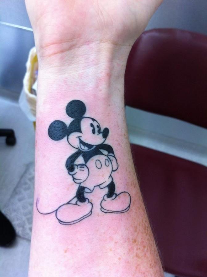 a6df338d05a69 Cool hand's Mickey Mouse tattoo on arm - | TattooMagz › Tattoo ...