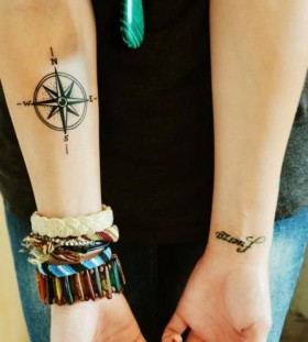 Cute girl's compass tattoo on arm