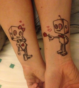 Cute red girl and boy robbot tattoo