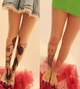 Funny duck and Mickey Mouse tattoo on leg