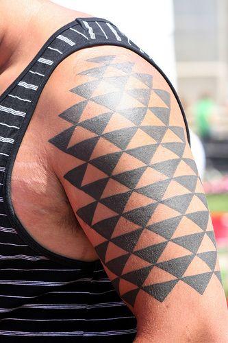 Geometric black geometric shoulder, back tattoo