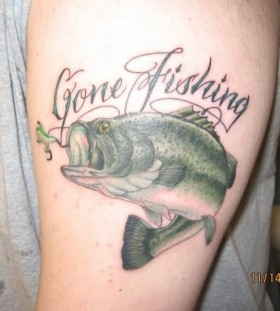 Gone fishing letters and green fishing tattoo