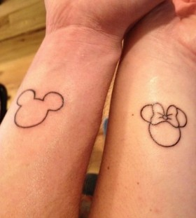 Gorgeous bow with Mickey Mouse tattoo on arm