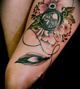 Gorgeous flowers compass tattoo on leg