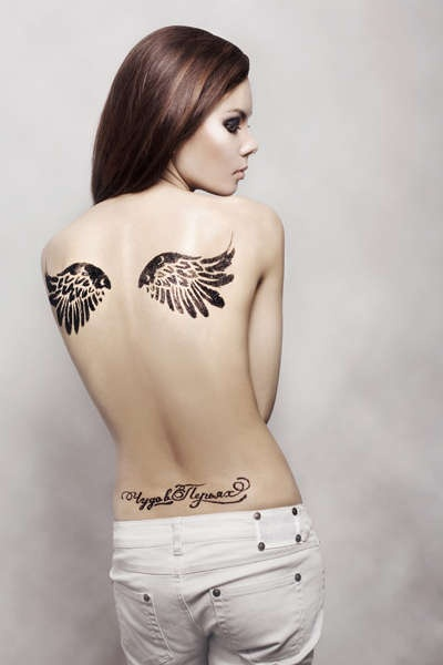 Great looking girl's angel tattoo on shoulder