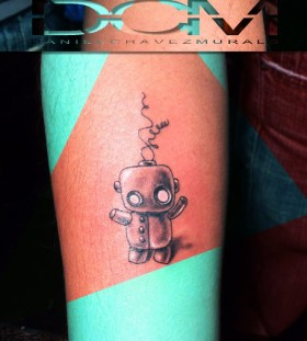 Green and black robbot tattoo