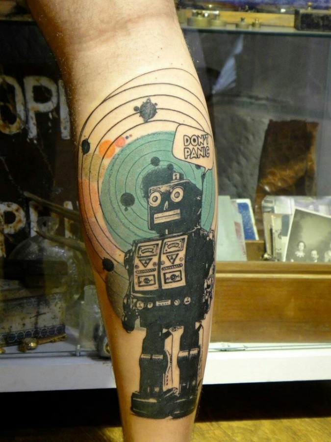 Green and don't panic robbot tattoo