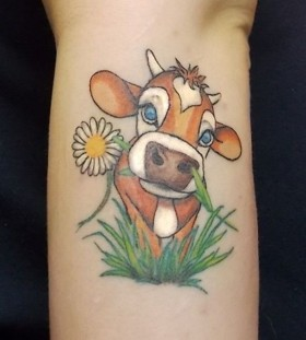 Green and yellow flower cow tattoo
