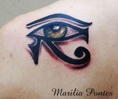 Green eye tattoo by Marilia Pontes