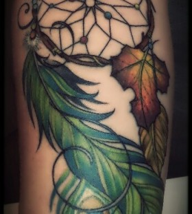 Green feather and yellow leaf peacock tattoo