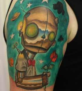 Green stars and robbot tattoo