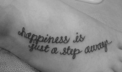 Happiness quote girl tattoo on foot