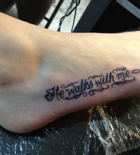 He walks with me girl tattoo on foot