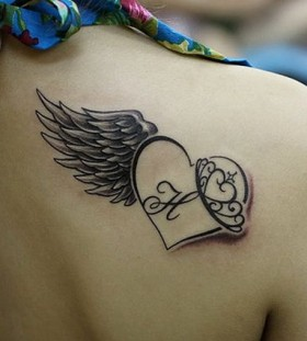 Letters, heart and angel tattoo on shoulder