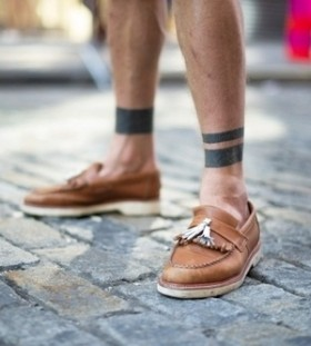 Lovely shoes and black men's geometric tattoo on leg