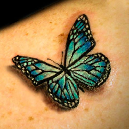 Lovely simple butterfly green tattoo
