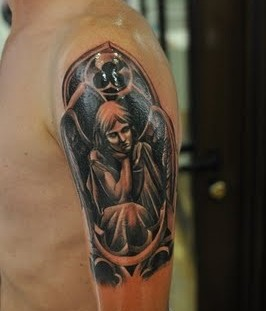 Men's black angel tatoo on arm