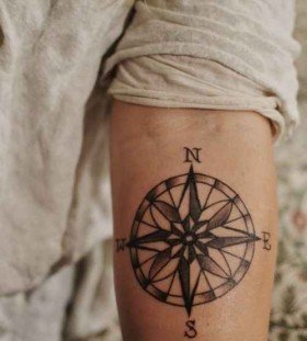 North and south compass tattoo on arm