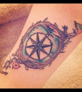 North, south, west compass tattoo on leg
