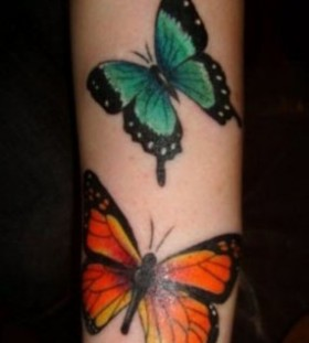 Orange and green butterfly tattoo