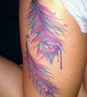 Pink colorful peacock tattoo on leg