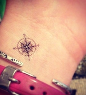Pretty small wrist compass tattoo on arm