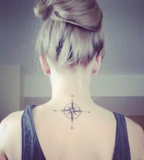 Pretty women's compass tattoo on back