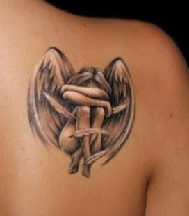 Realisti small girl's angel tattoo on shoulder