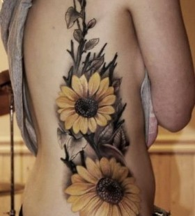Realistic girl's sunflowers yellow tattoo