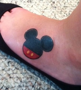 Red and black Mickey Mouse tattoo on leg