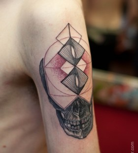 Red and black geometric arm tattoo