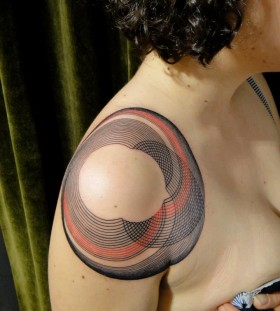Red and black geometric shoulder, back tattoo