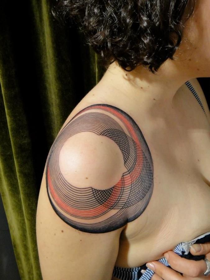 Red and black geometric shoulder, back tattoo