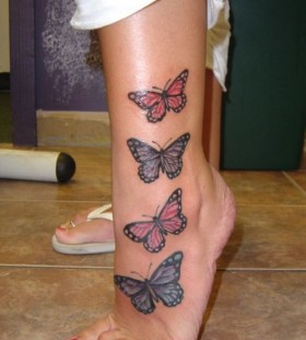 Red and blue butterflies girl tattoo on leg