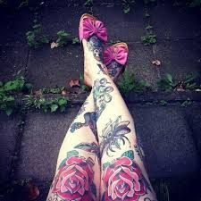 Red and pink flowers girl tattoo on leg