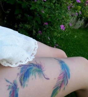 Red, blue, green peacock tattoo on leg