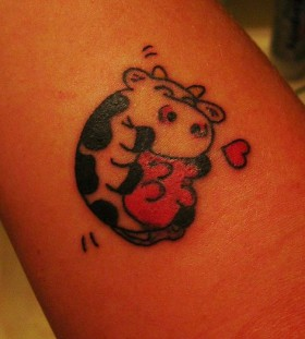 Red heart and cow tattoo