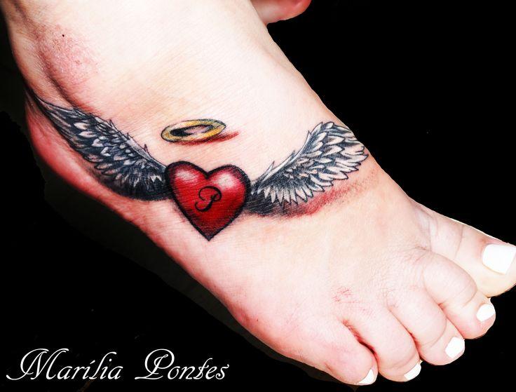 Red lovely heart tattoo by Marilia Pontes