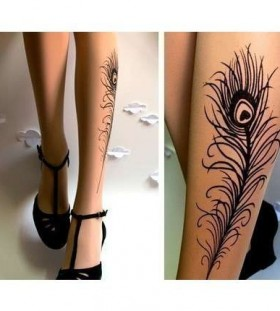 Simple black feather and black high-heels peacock tattoo on leg