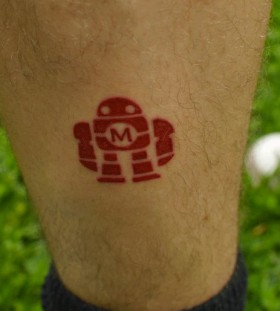 Small red robbot tattoo
