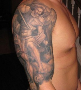 Strong men's angel tatoo on arm