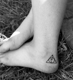 Stunning black Harry Potter tattoo